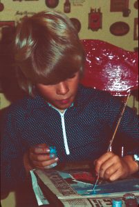 Ray at age 8 painting a landscape